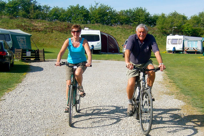 couple on bikes hired from Golden Square Caravan Park