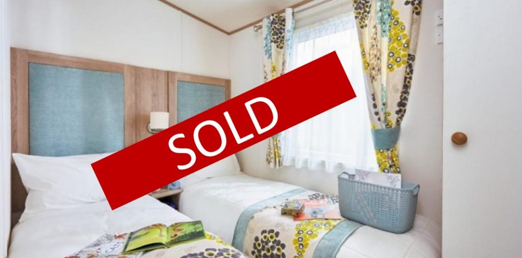Sold sign over a ABI St. David 2018 holiday home bedroom